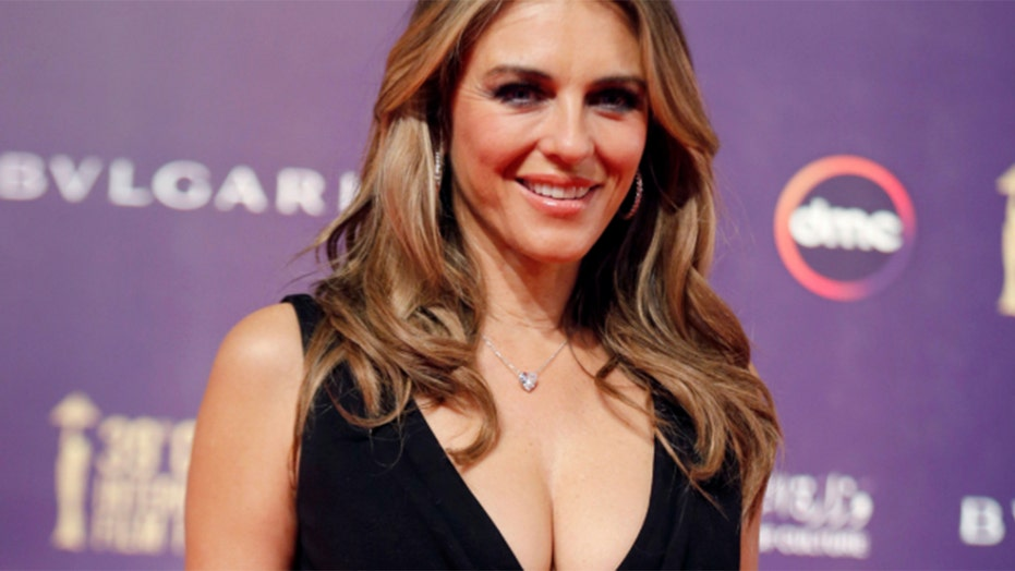 Elizabeth Hurley twins with sister in bikinis: 'We still love matching'
