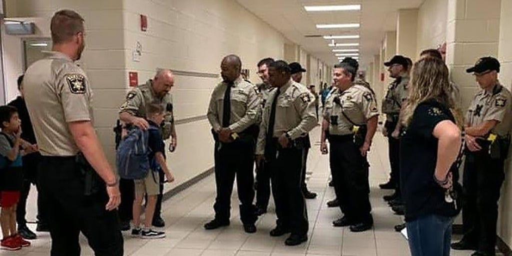 Georgia deputies walk son of fallen deputy to first day of fourth grade