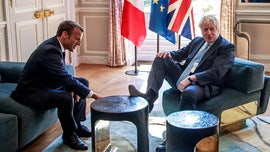 'Rude' Boris Johnson puts foot up on Elysee furniture during key Brexit talks with Macron
