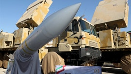 Iran unveils new long-range missile system in latest show of military force