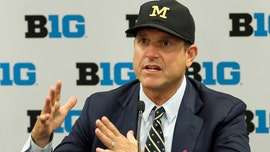 Michigan coach Jim Harbaugh on recruiting struggles: 'It's hard to beat the cheaters'
