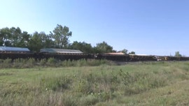 Severe thunderstorm winds in Kansas cause more than 100 cars on 2 trains to derail