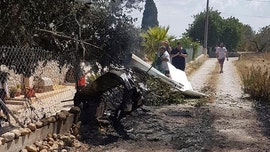 Sightseeing helicopter, small plane crash in midair over Spanish island of Mallorca; 7 dead