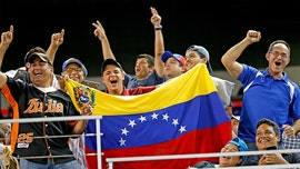 Major League Baseball banning players from Venezuelan Winter League during offseason
