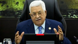 Palestinian leader fires advisers, wants bonuses returned