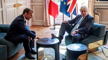'Rude' Boris Johnson puts foot up on Elysee furniture during key Brexit talks with Macron