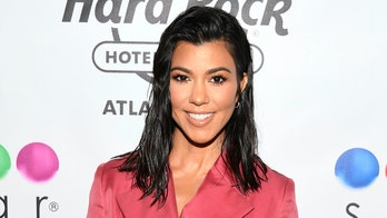 Kourtney Kardashian sizzles in lime-green bikini in pics from tropical getaway