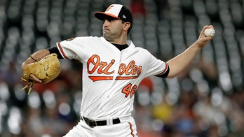 Baltimore Orioles' Richard Bleier gets into argument with coach in dugout