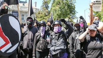 'I am Antifa' professor who posted desire to hit Trump with bat resigns from post