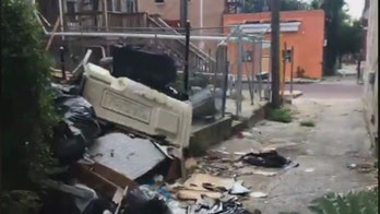 'Traveling Trash Men' converge on Baltimore in bid to clean up the city
