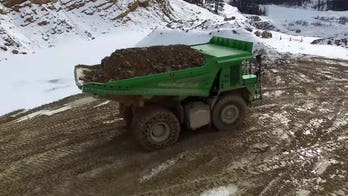 Giant electric dump truck runs on rocks and gravity