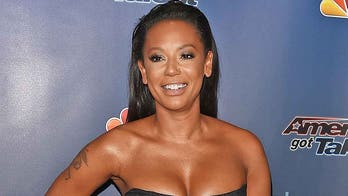 Mel B strips down for shower video with her dog