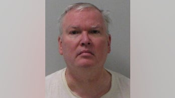 Michigan priest charged with binding boy in plastic, leaving him in closet