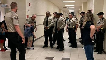 Hall County Sheriff's Office Deputy Nicolas Dixon's colleagues fill officer's shoes for his 9-year-old son