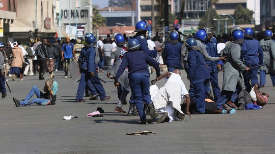 Zimbabwe protesters face tear gas, beatings from police during anti-government demonstrations