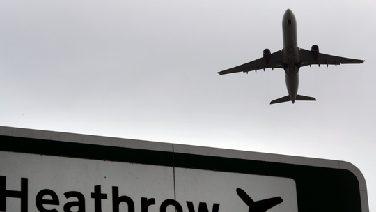 UK climate agency officials doubled air travel over previous year, report says