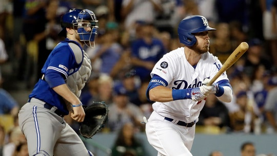 Los Angeles Dodgers' Cody Bellinger loses his pants sliding into third base