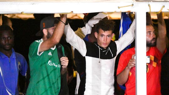Migrants disembark rescue ship in Italy after 19-day standoff