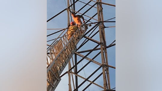 Naked man coaxed down from atop 150-foot Colorado power line tower, hospitalized