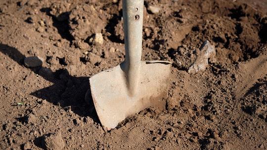 Kenyan officials exhume body to retrieve uniform