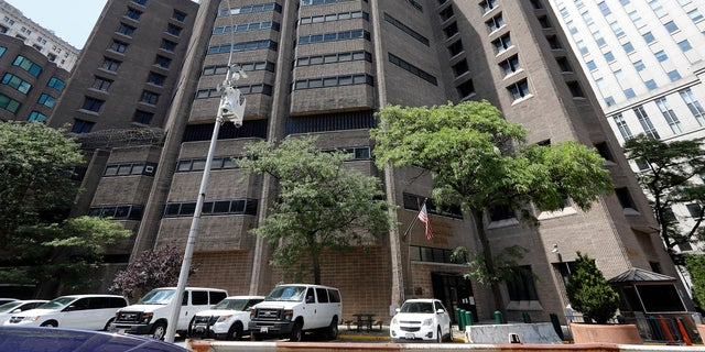 This July 1, 2019 photo shows the Metropolitan Correctional Center, in New York. Financier Jeffrey Epstein died by suicide while awaiting trial on sex-trafficking charges in New York, a former law enforcement official said Saturday. (AP Photo/Richard Drew)