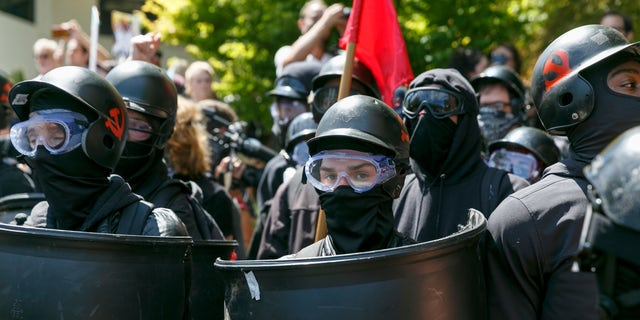 In this Aug. 4, 2018, file photo, counter-protesters prepare to clash with Patriot Prayer protesters during a rally in Portland, Ore. Portland police are mobilizing in hopes of avoiding clashes between out-of-state hate groups planning a rally Saturday and homegrown anti-fascists who say they'll come out to oppose them.