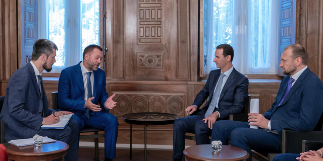 Syrian President Bashar Assad, second right, meets with a Russian delegation in Damascus, Syria, Aug. 20, 2019. (SANA via AP)