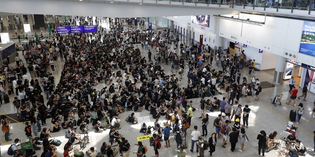 Protesters demonstrate at the airport in Hong Kong on Friday, Aug. 9, 2019. Pro-democracy protesters held a demonstration at Hong Kong's airport Friday even as the city sought to reassure visitors to the city after several countries issued travel safety warnings related to the increasing levels of violence surrounding the two-month-old protest movement.