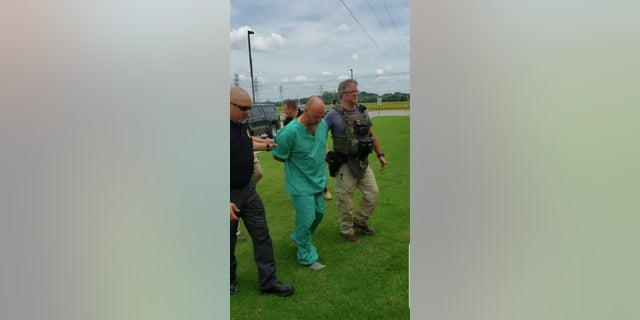 Curtis Watson being taken into custody after five days on the run following his prison escape.