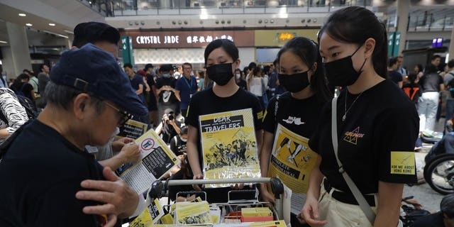 Protesters promote their cause at the airport In Hong Kong on Friday, Aug. 9, 2019. Pro-democracy protesters held a demonstration at Hong Kong's airport Friday even as the city sought to reassure visitors to the city after several countries issued travel safety warnings related to the increasing levels of violence surrounding the two-month-old protest movement.