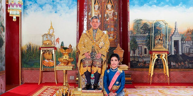 The palace posted pictures of King Maha Vajiralongkorn, 67, and his long-time girlfriend Sineenatra Wongvajirabhakdi, 34, pictured wearing formal regalia in the palace. (Thailand Royal Office via AP)