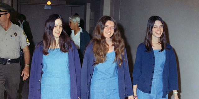 In this Aug. 20, 1970, file photo, Charles Manson followers, from left, Susan Atkins, Patricia Krenwinkel and Leslie Van Houten walk to court to appear for their roles in the 1969 cult killings of seven people in Los Angeles. (Associated Press)
