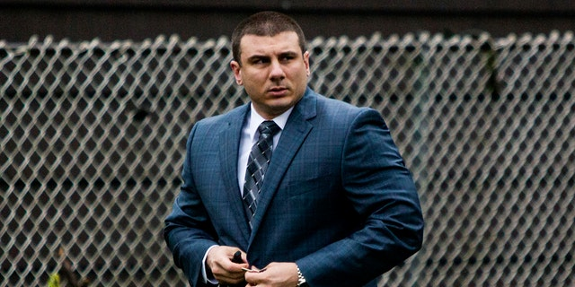 New York City Police Officer Daniel Pantaleo leaves his house Monday, May 13, 2019, in Staten Island, N.Y.
