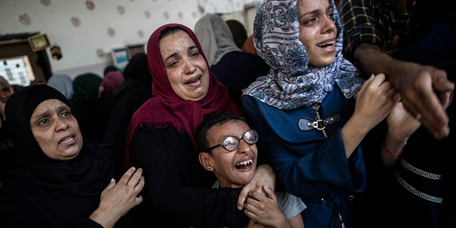Relatives mourn the death of Palestinian military Hamas Mohammed Abu Namus during his funeral in Gaza.