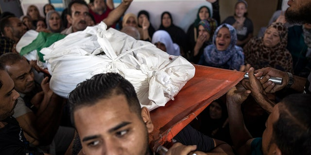 Grievances transporting the body of Palestinian Hamas fighter Mohammad Abu Namus during his funeral on Sunday