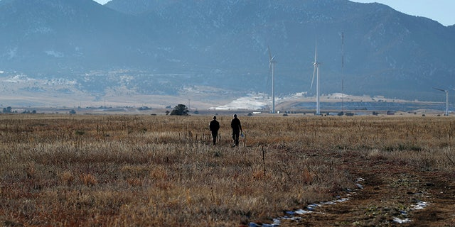 Hikers heading down a trail in the Rocky Flats National Wildlife Refuge in Broomfield, Colo., in November 2018. (AP Photo/David Zalubowski, File)
