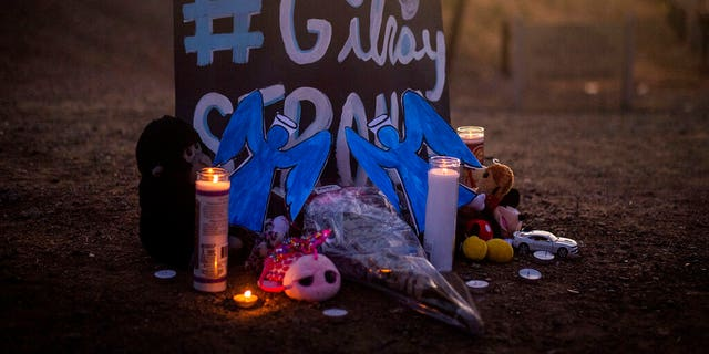Candles burn at a makeshift memorial for Gilroy Garlic Festival shooting victims outside the festival grounds, Monday, July 29, 2019, in Gilroy, Calif. (AP Photo/Noah Berger)