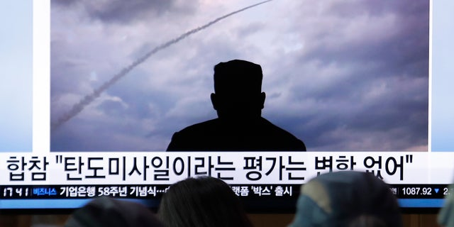 People watch a TV showing an image of North Korea's a multiple rocket launch during a news program at the Seoul Railway Station in Seoul, South Korea, Aug. 1, 2019. (Associated Press)