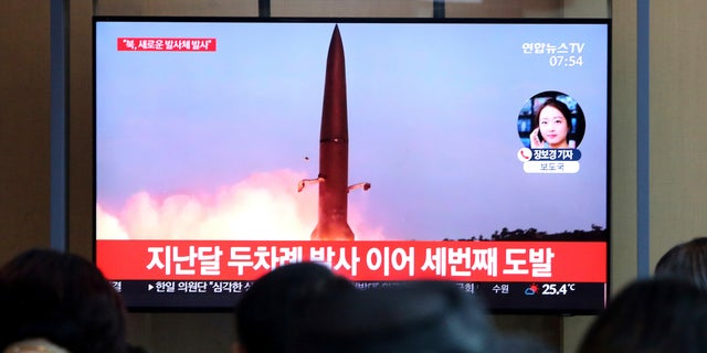 People watch a TV showing a file footage of a North Korea's missile launch during a news program at the Seoul Railway Station in Seoul, South Korea, Friday, Aug. 2, 2019. (Associated Press)