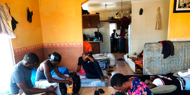 In this July 28, 2019, photo, Cameroonians wait in a rented apartment in Tijuana, Mexico, until their names are called to claim asylum in the U.S. (AP Photo/Elliot Spagat)