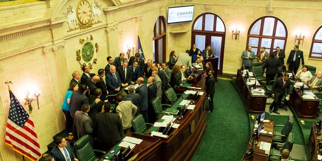 Puerto Rico's House of Representatives prepares to vote on whether to confirm Pedro Pierluisi as secretary of state, in San Juan, Puerto Rico on Friday. The confirmation removes an important obstacle to him becoming governor. But Pierluisi's fate remains unclear. (AP Photo/Dennis M. Rivera Pichardo)