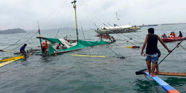 At least 25 people were dead and six others were missing off the coast of the Philippines on Sunday, officials said.