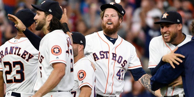Houston Astros relief pitcher Chris Devenski, second from right, and teammates celebrate the team's 9-0 win over the Seattle Mariners, with a four-pitcher combined no-hitter, in a baseball game Saturday, Aug. 3, 2019, in Houston. (Associated Press)