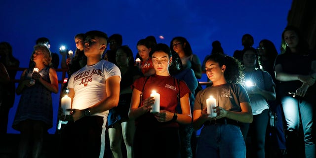 From left, Samuel Lerma, Arzetta Hodges and Desiree Quintanar attend a vigil for victims of the deadly shooting that occurred earlier in the day at a shopping center Saturday, Aug. 3, 2019, in El Paso, Texas. (Associated Press)