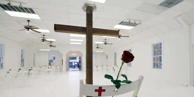 "FILE - In this Nov. 12, 2017, file photo, a rose rests on a chair during a memorial for the victims of the shooting at Sutherland Springs First Baptist Church at the church in Sutherland Springs, Texas. At the church where more than two dozen people were killed by a gunman in 2017, Pastor Frank Pomeroy sought to boost his followers' resolve with upbeat remarks at Sunday's service. He urged them not to live ""in a spirit of fear."" (AP Photo/Eric Gay, File)"