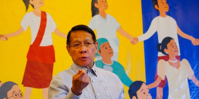 In this April 30, 2019 file photo, Philippine Health Secretary Dr. Francisco Duque III displays a graph showing the decline of the measles outbreak in the country during a press conference during World Immunization Week 2019 in Manila, Philippines. The Philippines' Department of Health has declared the country's massive outbreak of dengue to be a national epidemic on Tuesday Aug. 6, 2019.