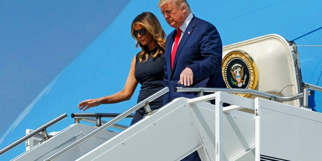 President Donald Trump and First Lady Melania Trump arrive at Wright-Patterson Air Force Base, Wednesday, Aug. 7, 2019, in Dayton, Ohio.  (Ty Greenlees/Dayton Daily News via AP, Pool)