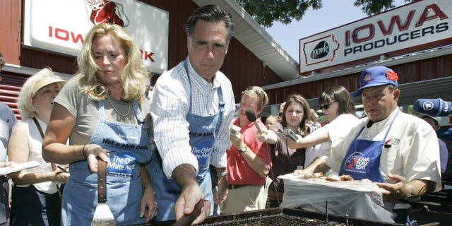 FILE - In this Aug. 10, 2007, file photo, Republican presidential candidate Mitt Romney, and his wife Ann, flip pork chops in the Iowa Pork Producers tent at the Iowa State Fair in Des Moines, Iowa. The state fair, a quadrennial presidential prerequisite stop, is a cultural obstacle course more fraught with pitfalls than opportunities to sway the narrow band of voters who will attend the kickoff caucuses in less than six months. (AP Photo/Charlie Neibergall, File)