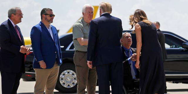 President Trump greets Sen. John Cornyn, R-Texas, as Sen. Ted Cruz, R-Texas, second from left, and El Paso Mayor Dee Margo, watch, as first lady Melania Trump greets Texas Gov. Greg Abbott. (AP Photo/Evan Vucci)