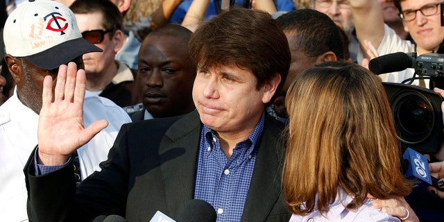 """In this March 14, 2012, file photo, former Illinois Gov. Rod Blagojevich, with his wife Patti at his side, speaks to the media in Chicago before reporting to federal prison in Denver. President Donald Trump says he's """"very strongly"""" considering commuting the sentence of Blagojevich, who is serving a 14-year prison term on multiple federal corruption convictions. (AP Photo/M. Spencer Green, File)"""
